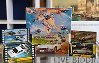 """BNPS.co.uk (01202 558833)<br /> Pic: ZacharyCulpin/BNPS<br /> <br /> Pictured: The sale features James Bond toy cars, airfix models and construction sets.<br /> <br /> An exact replica of the secret weapons case used by Sean Connery's 007 in From Russia With Love has emerged for sale for £14,000. <br /> <br /> The black attache case is one of only 100 models ever produced and has been described by experts as the """"holy grail"""" of James Bond memorabilia. <br /> <br /> The replica is to be sold alongside dozens of sought-after Bond items, including a set of 21 hand painted Corgi model figures, at Ewbank's Auctions of Woking, Surrey."""