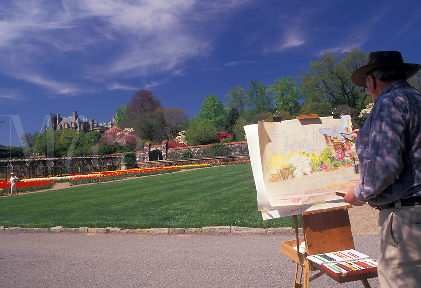 AJ2647, Asheville, Biltmore Estate, artist, Biltmore, North Carolina, Artist painting a picture of the Biltmore House inside the Walled flower Garden in the spring at Biltmore Estate in Asheville in the state of North Carolina.