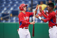 GCL Phillies center fielder Mickey Moniak (15) high fives Daniel Brito (21) after scoring a run during a game against the GCL Blue Jays on August 16, 2016 at Bright House Field in Clearwater, Florida.  GCL Blue Jays defeated GCL Phillies 2-1.  (Mike Janes/Four Seam Images)