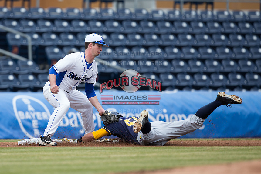 Aaron Knapp (23) of the California Golden Bears is tagged out at third base by Max Miller (5) of the Duke Blue Devils at Durham Bulls Athletic Park on February 20, 2016 in Durham, North Carolina.  The Blue Devils defeated the Golden Bears 6-5 in 10 innings.  (Brian Westerholt/Four Seam Images)