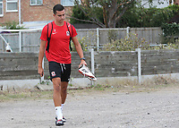 Will Thomas of Ramsgate arrives at the ground in his full kit as he walks towards the dressing room carrying his boots during Ramsgate vs Folkestone Invicta, Friendly Match Football at Southwood Stadium on 1st August 2020