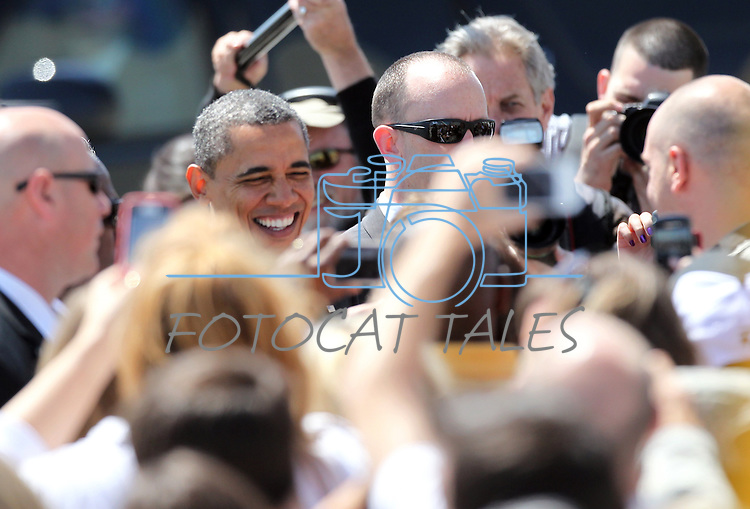 President Barack Obama greets the crowd at the Reno-Tahoe International Airport, in Reno, Nev. on Friday, May 11, 2012. (AP Photo/Cathleen Allison)