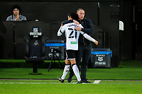 Yan Dhanda of Swansea City is hugged by Steve Cooper Head Coach of Swansea City after being subbed during the Sky Bet Championship match between Swansea City and Blackburn Rovers at the Liberty Stadium in Swansea, Wales, UK. Saturday 31 October 2020