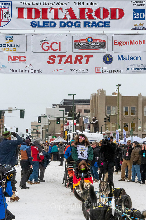 Sean Underwood and team leave the ceremonial start line with an Iditarider and handler at 4th Avenue and D street in downtown Anchorage, Alaska on Saturday March 7th during the 2020 Iditarod race. Photo copyright by Cathy Hart Photography.com