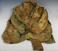 BNPS.co.uk (01202 558833)<br /> Pic: LindsayBurns/BNPS<br /> <br /> Pictured: Marine Jock Mathieson's airborne troop smock.<br /> <br /> The medals, weapons and personal effects of a hero D-Day commando have sold for over £11,000 - 22 times their estimate.<br /> <br /> Marine Jock Mathieson narrowly escaped death during the Normandy landings on June 6, 1944.<br /> <br /> A bullet pierced the fuel tank of his motorbike which he was carrying above his head while wading through the sea towards Juno Beach.