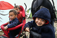 Pictured: Young migrant children in push chairs Tuesday 08 March 2016<br /> Re: Heavy overnight rain has flooded the migrant camp at the Greek FYRO Macedonian border of Idomeni in Greece