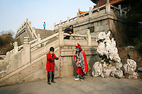 CHINA. Hubei Province. Wuhan. A woman training a man in traditional Chinese performing arts outside of The Yellow Crane Tower which looks over the Yangtze and the city of Wuhan.Wuhan (population 4.3 million) is a sprawling city that sits on both sides of the Yangtze River.  2008.
