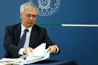 The minister of economy Daniele Franco looking for documents during the press conference after the minister's cabinet.<br /> Rome (Italy), October 5th 2021<br /> Photo Samantha Zucchi Insidefoto