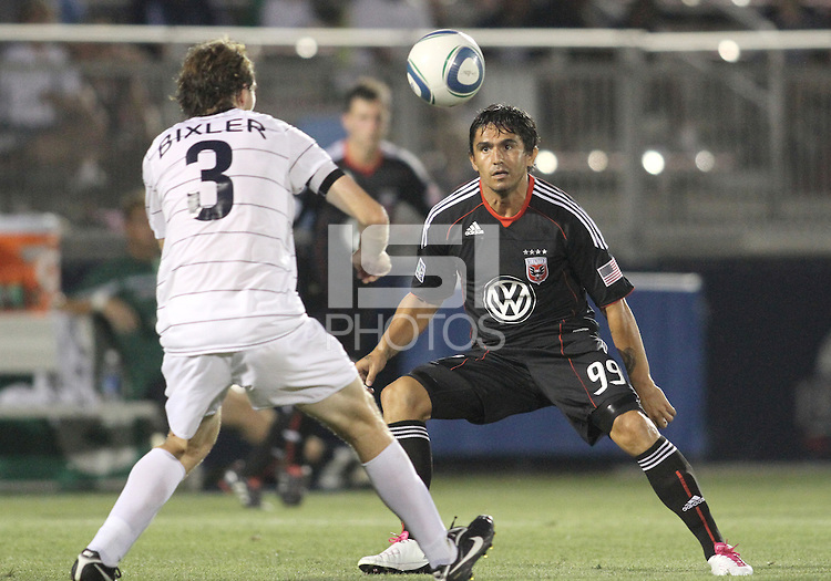 Jaime Moreno #99 of D.C. United goes for a loose ball with Dustin Bixler #3 of the Harrisburg City Islanders during a US Open Cup match at the Maryland Soccerplex on July 21 2010, in Boyds, Maryland. United won 2-0.