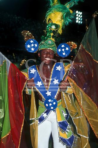 Rio de Janeiro, Brazil. Samba dancer in costume themed on the Brazilian flag during the carnival parade.