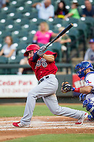 Memphis Redbirds third baseman Pete Kozma (8) swings the bat during the second game of a Pacific Coast League doubleheader against the Round Rock Express on August 3, 2014 at the Dell Diamond in Round Rock, Texas. The Redbirds defeated the Express 7-6. (Andrew Woolley/Four Seam Images)