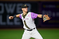 """Akron RubberDucks third baseman Nolan Jones (17) throws to first base during an Eastern League game against the Erie SeaWolves on August 30, 2019 at Canal Park in Akron, Ohio.  Akron wore special jerseys with the slogan """"Fight Like a Kid"""" during the game for Akron Children's Hospital Home Run for Life event, the design was created by 11 year old Macy Carmichael.  Erie defeated Akron 3-2.  (Mike Janes/Four Seam Images)"""
