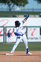 Surprise Saguaros third baseman Vladimir Guerrero Jr. (27), of the Toronto Blue Jays organization, celebrates after hitting a double during an Arizona Fall League game against the Salt River Rafters on October 9, 2018 at Surprise Stadium in Surprise, Arizona. The Rafters defeated the Saguaros 10-8. (Zachary Lucy/Four Seam Images)