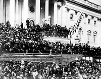 Abraham Lincoln giving his second Inaugural Address (4 March 1865)<br /> <br /> This photograph (top) of Lincoln delivering his second inaugural address is the only known photograph of the event. Lincoln stands in the center, with papers in his hand. John Wilkes Booth is visible in the photograph, in the top row right of center (White, The Eloquent President). The second photo highlights both Lincoln and Booth from the photo above.<br /> <br /> The second inaugural address of Abraham Lincoln, given on 4 March 1865 on the east portico of the U.S. Capitol.