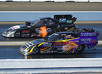 Nov 11, 2017; Pomona, CA, USA; NHRA funny car driver Bob Bode (near) races alongside Del Worsham during qualifying for the Auto Club Finals at Auto Club Raceway at Pomona. Mandatory Credit: Mark J. Rebilas-USA TODAY Sports