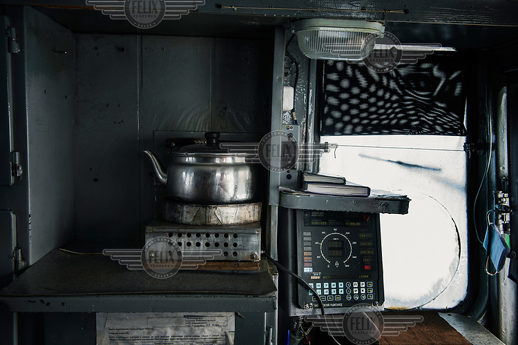A kettle in the driver's cab of a locomotive on the Obskaya-Bovanenkovo railway as it travels to the Gasprom Bovanenkovo gas field.