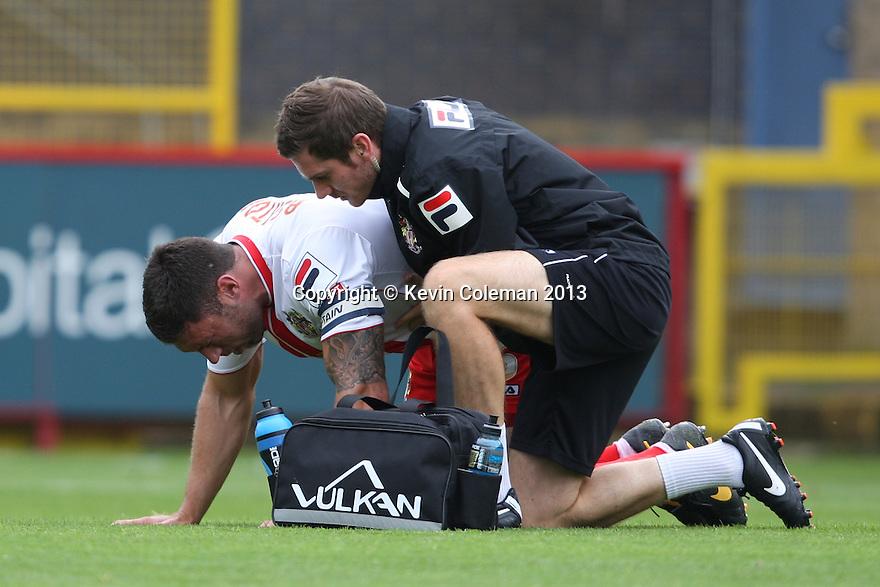 Jon Ashton of Stevenage is treated by physio Paul Dando<br />  - Stevenage v Carlisle Untied - Sky Bet League 1 - Lamex Stadium, Stevenage - 21st September, 2013<br />  © Kevin Coleman 2013
