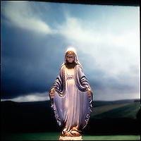 Virgin Mary figurine in landscape forground<br />