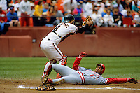 SAN FRANCISCO, CA: Kirt Manwaring of the San Francisco Giants tags out Cincinnati Reds base runner Barry Larkin at home plate during their game at Candlestick Park in San Francisco, California on June 18, 1992. (Photo by Brad Mangin)