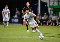 LAKE BUENA VISTA, FL - JULY 18: Cristian Pavón #10 of LA Galaxy chases the ball during a game between Los Angeles Galaxy and Los Angeles FC at ESPN Wide World of Sports on July 18, 2020 in Lake Buena Vista, Florida.