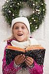 USA, Illinois, Metamora, Portrait of girl (6-7) singing carols