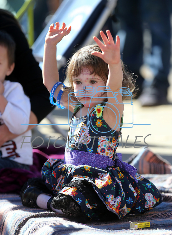Adaline Rotoli, 2, watches the 79th Nevada Day parade in Carson City, Nev., on Saturday, Oct. 28, 2017. <br />Photo by Cathleen Allison/Nevada Momentum