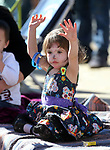 Adaline Rotoli, 2, watches the 79th Nevada Day parade in Carson City, Nev., on Saturday, Oct. 28, 2017. <br />