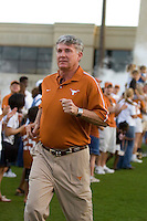 01 APRIL 2006: University of Texas head coach Mack Brown runs onto the field at Darrell K. Royal Memorial Stadium before the Longhorns annual spring Orange vs White Scrimmage.