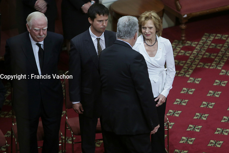 Quebec Premier Philippe Couillard gives his condolences to Lisette Lapointe, wife of former Quebec premier Jacques Parizeau, as her husband lies in state at the National Assembly in Quebec City on Sunday June 7, 2015.<br /> <br /> PHOTO :  Francis Vachon - Agence Quebec Presse