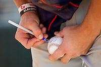 Bryce Harper #34 of the Hagerstown Suns autographs a baseball for a fan following the game against the Kannapolis Intimidators at Fieldcrest Cannon Stadium on May 30, 2011 in Kannapolis, North Carolina.   Photo by Brian Westerholt / Four Seam Images