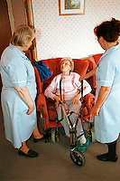 Elderly resident of a care home with her nurses. This image may only be used to portray the subject in a positive manner.<br /> ©shoutpictures.com<br /> <br /> john@shoutpictures.com