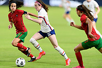 HOUSTON, TX - JUNE 10: Rose Lavelle #16 of the United States brings the ball up the field with Dolores Silva #14 of Portugal right beside her during a game between Portugal and USWNT at BBVA Stadium on June 10, 2021 in Houston, Texas.