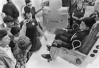 1967 FILE PHOTO - ARCHIVES -<br /> <br /> Thrill of a lifetime comes to Bob Poissand of Davenport Road public school as he sits in real astronaut's seat in U.S. pavilion at Expo and listens to guide Mary Perk. Bob and the schoolmates around him are among the 770 children in grades 5 to 8 visiting the fair; first of 17;000 Metro children who'll get four-day trips for $30 each. They're enjoying it; despite the long walks and delayed lunch.<br /> <br /> PHOTO : Reg INNELL - Toronto Star Archives - AQP