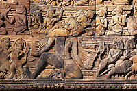 Banteay Srei with bas relief in red sandstone showing Ravana shaking Mount Kailasa (E pediment of S Library), 10th century Khmer  architecture at Angkor Wat -  Siem Reap, Cambodia...