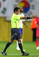 Mexican referee Benito Archundia signals the end of the game. The Korea Republic and France played to a 1-1 tie in their FIFA World Cup Group G match at the Zentralstadion, Leipzig, Germany, June 18, 2006.