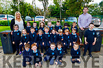 Barry O'Leary (Principal) and Michelle O'Brien (Teacher) stand with the junior infants in O'Breannan  NS on Monday.