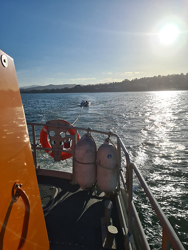 Dun Laoghaire RNLI's All-Weather Lifeboat assisting vessel in Killiney Bay