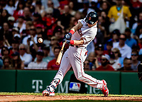 Jun 22, 2019; Boston, MA, USA; Boston Red Sox left fielder Andrew Benintendi connects for a two-RBI double in the second inning against the Toronto Blue Jays at Fenway Park. Mandatory Credit: Ed Wolfstein-USA TODAY Sports