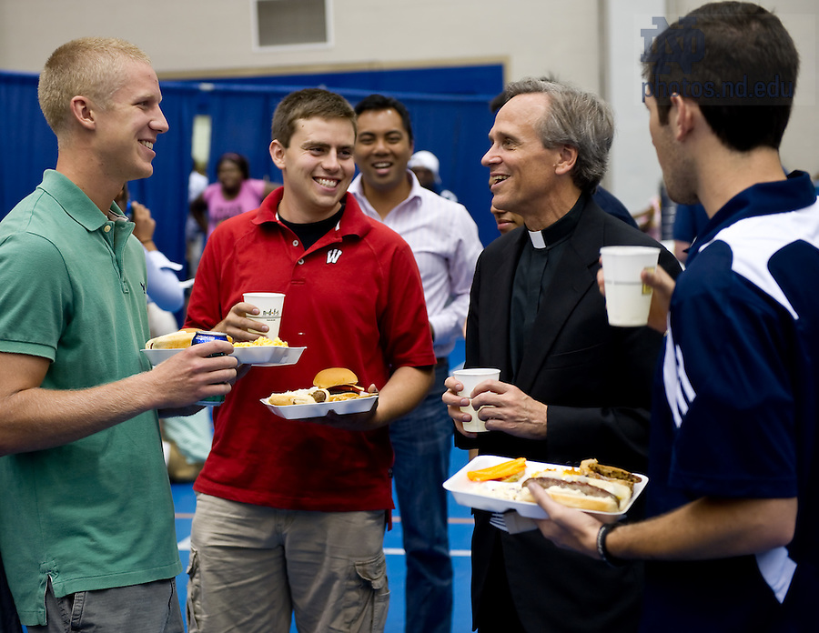 Aug. 23, 2011; University president Rev. John I. Jenkins, C.S.C. chats with students at a picnic in the Joyce Center following the 2011 opening Mass. ..Photo by Matt Cashore/University of Notre Dame
