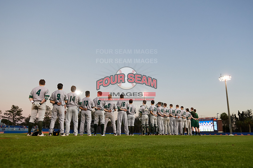Siena Saints line up for the national anthem before a game against the Florida Gators on February 16, 2018 at Alfred A. McKethan Stadium in Gainesville, Florida.  Florida defeated Siena 7-1.  From left;  Jordan Bishop (4), Marcos Campos (9), Brian Kelly (14), Yasser Santana (10), Matt Hamel (6), Dan Lowndes (8), Jonathan Crimmin (16), Brendan Conley (1), Craig Corliss (24), Josh Delsignore (20), Tommy Miller (42), Nico Ramos (44), Tim Carroll (28), Joe Drpich (47), John Nolan (21), and Nick Bruno (32).  (Mike Janes/Four Seam Images)