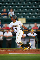 Bradenton Marauders third baseman Ke'Bryan Hayes (31) follows through on a swing during a game against the Clearwater Threshers on April 18, 2017 at LECOM Park in Bradenton, Florida.  Clearwater defeated Bradenton 4-2.  (Mike Janes/Four Seam Images)