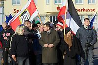 Zum 75. Jahrestag der Reichspogromnacht marschierten bis zu 200 Neonazis von der NPD durch die mecklenburgische Kleinstadt Friedland und protestierten gegen ein geplantes Fluechtlingsheim.<br />Mehrere hundert Gegendemonstranten demonstrierten lautstark gegen den Aufmarsch.<br />300 Polizeibeamte sicherten den reibungslosen Ablauf der NPD-Veranstaltung.<br />In der Bildmitte: Udo Pastoers, Fraktionsvorsitzender der NPD im Mecklenburger Landtag und Mitglied im Bundesvorstand der NPD.<br />9.11.2013, Berlin<br />Copyright: Christian-Ditsch.de<br />[Inhaltsveraendernde Manipulation des Fotos nur nach ausdruecklicher Genehmigung des Fotografen. Vereinbarungen ueber Abtretung von Persoenlichkeitsrechten/Model Release der abgebildeten Person/Personen liegen nicht vor. NO MODEL RELEASE! Don't publish without copyright Christian-Ditsch.de, Veroeffentlichung nur mit Fotografennennung, sowie gegen Honorar, MwSt. und Beleg. Konto:, I N G - D i B a, IBAN DE58500105175400192269, BIC INGDDEFFXXX, Kontakt: post@christian-ditsch.de<br />Urhebervermerk wird gemaess Paragraph 13 UHG verlangt.]