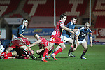 Scarlets replacement scrum half Rhodri Williams kicks the ball away from the breakdown.<br /> Celtic League<br /> Scarlets v Munster<br /> <br /> 01.03.14<br /> <br /> ©Steve Pope-SPORTINGWALES