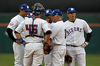 Buffalo Bisons manager Wally Backman #8 makes a pitching change as catcher Rob Johnson #46, third baseman Matt Tuiasosopo (left) Bobby Scales (back) and Zach Lutz #3 (right) look on during a game against the Pawtucket Red Sox at Coca-Cola Field on April 15, 2012 in Buffalo, New York.  Buffalo defeated Pawtucket 10-9 in ten innings.  (Mike Janes/Four Seam Images)