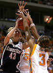KNOXVILLE, TN--07 JANUARY 2005- 010706JS02-<br /> UConn's Ann Strother gets her shot blocked by  Tennessee's Candace Parker (3) and Nicky Anosike (55) during their game Saturday at the Thompson-Boling Arena in Knoxville, Tennessee. Strother finished with a game-high 25 points in their 80-89 loss. --Jim Shannon Republican American--UConn; Tennessee; Thompson-Boling Arena; Knoxville; Tennessee; Nicky Anosike, Candace Parker, Ann Strother  are CQ