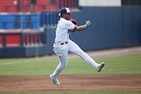 Kannapolis Cannon Ballers third baseman Lency Delgado (5) makes a throw to second base against the Carolina Mudcats at Atrium Health Ballpark on June 13, 2021 in Kannapolis, North Carolina. (Brian Westerholt/Four Seam Images)
