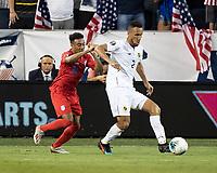 KANSAS CITY, KS - JUNE 26: Francisco Palacios #2 dribbles away from Jonathan Lewis #18 during a game between Panama and USMNT at Children's Mercy Park on June 26, 2019 in Kansas City, Kansas.