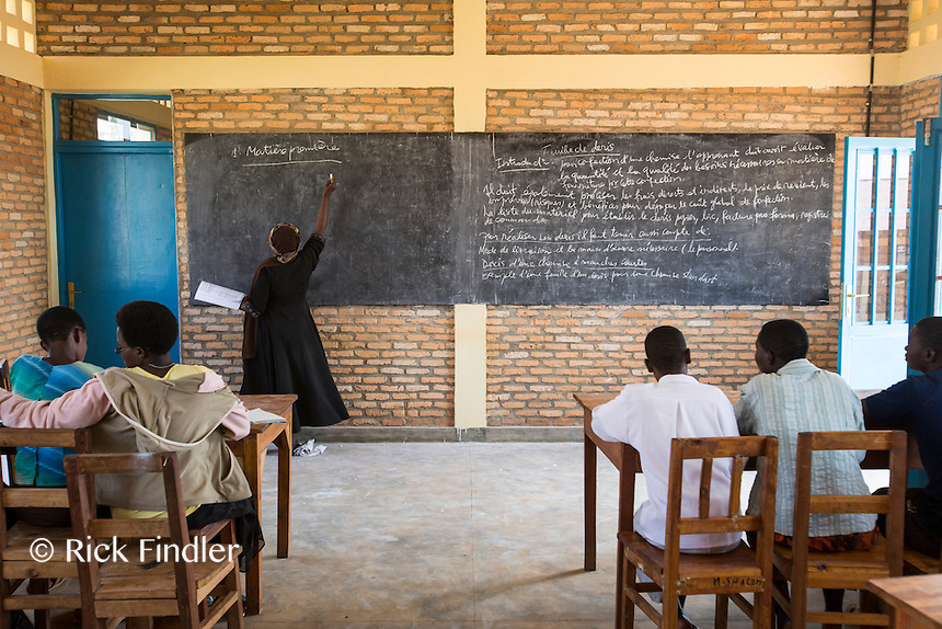 BURUNDI, Ruyigi: 10 June 2015 Ruyigi Re-education Centre Feature.<br /> See accompanying article for general information. <br /> Pictured: Children pay attention to a teacher during a skills lesson at the centre. <br /> Rick Findler / Story Picture Agency