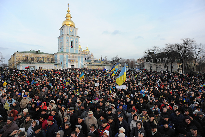 People that have been dispersed regather in front of the nearby Mykhailiv monastery to continue the  protest  after the violent repression  on main square perfomed by the riot police, Kiev.