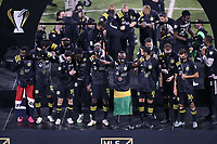 COLUMBUS, OH - DECEMBER 12: Columbus Crew players, wearing their champions medals, wait on stage for the trophy lift after a game between Seattle Sounders FC and Columbus Crew at MAPFRE Stadium on December 12, 2020 in Columbus, Ohio.